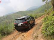 toyota fortuner exterior photo rear three quarter motion