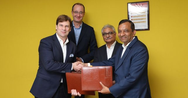 Jim Farley, Ford executive vice president and president of Global Markets, & Peter Fleet, Group vice president & president, Ford Asia Pacific with Rajan Wadhera, president, automotive sector and Dr Pawan Goenka, Managing Director, Mahindra and Mahindra Ltd.