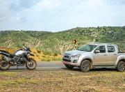 BMW R 1250 GS Pro and Isuzu D Max V Cross Side View
