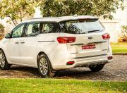 kia carnival image rear three quarter
