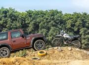 Mahindra Thar Petrol AT and Hero Xpulse 200 offroad hill side view